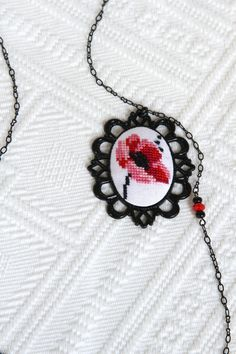 Hand embroidered Poppy necklace in black vintage frame Black