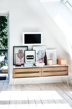 Low console table/ propped up art via Bolig Magasinet Photo: Anitta Behrendt