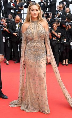 RITA ORA: The singer wears a gold embroidered gown with a halter neckline and split sleeves from Elie Saab Haute Couture at the 70th Anniversary Celebration.
