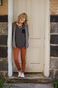 Brown jeans, polka dot top, gray cardigan