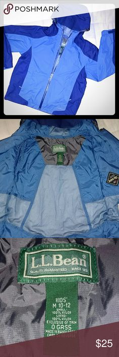 NWOT L.L.Bean Gore-Tex Windbreaker/Rain jacket Never worn, medium blue and navy blue windbreaker rain jacket. Velcro adjustable sleeves, two zipper side pockets, one zipper inner pocket. Reflective logo on back. This jacket is size 10-12. Also have same exact jacket in same condition in size 8. L.L. Bean Jackets & Coats