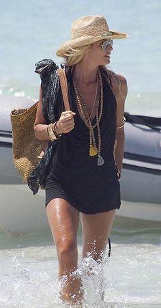 Bohemian beach babe perfection. Elle. Love the layered Tibetian beads & straw cowboy beach hat.