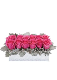 Alternative Dozen Rose Valentine's Day Arrangement: Bright pink super-sized roses surrounded by soft gray dusty miller, in a mirrored vase. —Florists' Review. Mirror Strips Vase, JamaliGarden.com