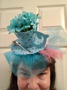 First tea cup fascinator I made for Alice in Wonderland party. My design, pattern worked using a plastic plate and cup covered with fabric on top of a plastic headband.