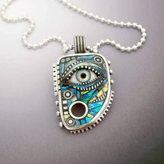 CIJ SALE Sterling Silver Pendant with Eye inlaid with Blue Green Iridescent Mosaic Polymer. $250.00, via Etsy.