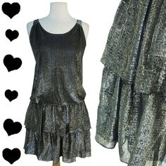 Check out this item in my Etsy shop https://www.etsy.com/listing/252897553/vintage-dress-70s-80s-silver-metallic