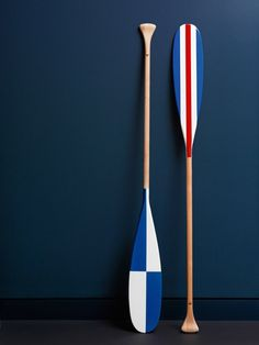 Painted oars in the French colors.                                                                                                                                                                                 Plus