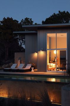 Like the combination of corrugated metal siding and windows and flat rooflines.  Nice!  modern pool by Webber + Studio, Architects