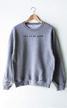 - Description - Size Guide Details: Chill in our soft & cozy oversized sweater in grey with print featuring 'Talk To Me Later'. Oversized, Unisex fit. Brand: NYCT Clothing. 50% Cotton, 50% Polyester.