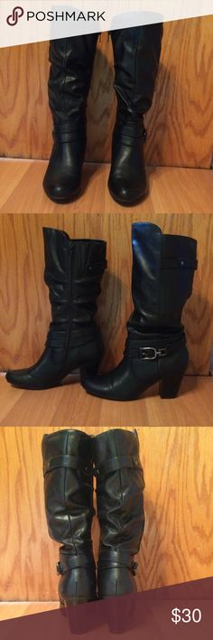 Black Leather Boots Black leather boots with attached buckle boot strap. The zip up the inside and have a 3 inch heel. Only worn twice. White Mountain Shoes Heeled Boots