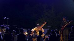 People dance as Indian sitar player Ashwin Batish performs with his Sitar Power band at the Ghanafest folk music festival in Floriana, outside Valletta