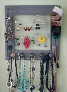 for years i've been hanging my necklaces off those black paper clippy things that look like Barbie purses, hanging from twine pinned to my wall with thumb tacks. TACKY is right. This is such an amazing solution instead. Wire mesh (rabbit fencing or other), frame, mismatched door knobs, and you have DIY jewelry holder. Awesome.