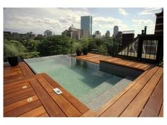 This incredible rooftop infinity pool, flanked by a wide wood deck, transforms into a hot tub at the flip of a switch. The pool also features a high-intensity swim jet for a vigorous workout. Infinity Pools, Infinity Edge Pool, Infinity Pool Backyard, Wood Pool Deck, Pool Decks, Decking, Backyard Decks, Cedar Deck, Deck Patio
