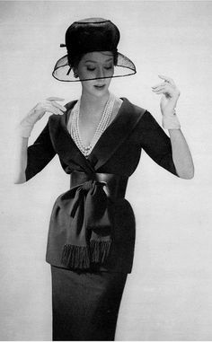 1959 Model in navy wool two-piece dress cinched with a wide leather belt ,the afternoon dress is called Jasmine designed by Jules-François Crahay for Nina Ricci