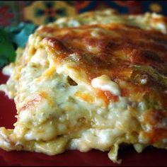 Chicken Enchilada Lasagna - oil, chicken breast, Mexican blend cheese, cream of celery and chicken, sour cream, green chiles, corn tortillas, cumin and salt/pepper