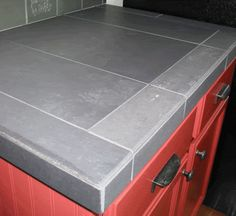 porcelain tile which here looks like concrete larger 1x2 foot pieces with - Tile Kitchen Countertops Ideas