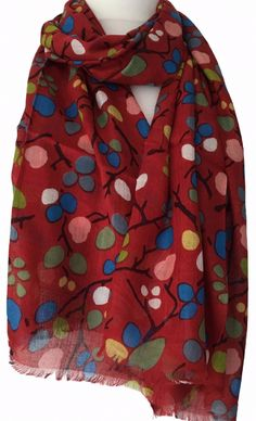 A large red scarf with an abstract tree floral print by British Designer Julie…