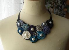 bib statement necklace with fabric, resin and metal flowers and pearls. $17.00, via Etsy.