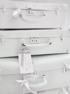 Painted white suitcases
