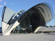 one of my fav modern buildings of the world.  Standing in it is just jaw dropping.  Every surface is sculpted & poetic.  Situated outside Lyon France, & designed by Santiago Calatrava - this building is imposing on the landscape but so beautifully primal - there isn't any other way to describe the beauty he has created from simple materials.