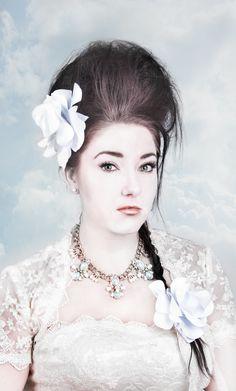 Barock white lady white flower in her hair.