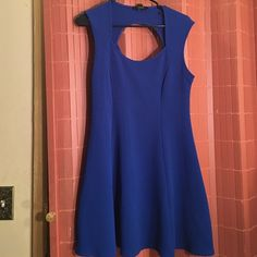 Skater Dress This royal Blue skater dress is so cute! It has a cut in the front and back. The style is very flattering and perfect for the summer! Can fit a XLarge too Forever 21 Dresses Midi