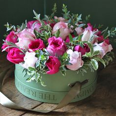Flowers in a hat box:  cute bridal shower centerpiece idea
