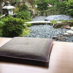 A Japanese zabuton is a large, usually square-shaped cushion used to sit or kneel on the floor.