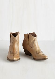 The Styled, Wild West Bootie in Sand. Have a passion for pioneering fashion frontiers? #brown #modcloth