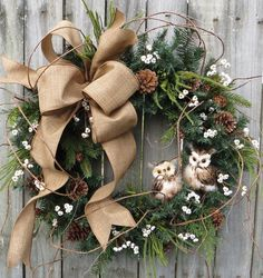 In this Christmas and wintertime wreath, a lovely Linen finish bow and a pair of adorable owls are the focal point. Beautiful greenery, tallow Owl Wreaths, Wreath Ideas, Wreaths For Front Door, Winter Wreaths, Holiday Wreaths, Christmas Colors, Burlap Christmas, All Things Christmas, Noel Christmas