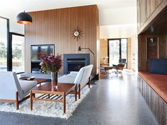 60's Grand Designs Australia- polished concrete floors with stones, recycled wood on nook, recycled basketball flooring, hanging lights.. Make the lounge room sunken and you have a winner!!