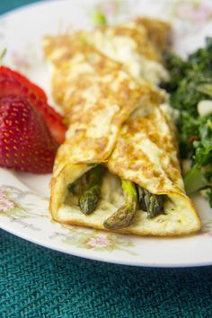 Spring Asparagus Omelette | These omelettes stole the show, stuffed with prosciutto and garlicky asparagus. @summersher