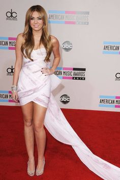 Miley Cyrus in Marchesa at the American Music Awards. See all of the singer's wild looks.