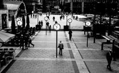 time waits for no man by Marc Melander - 'Six clocks' installation at London's Canada Square (Canary Wharf).