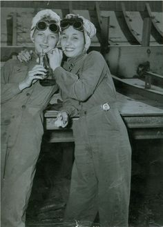 Bennice Vick Russell and sister-in-law Marjorie Vick share a soda during a break at Brown Shipbuilding Co. in Houston, TX, 1944. Bennice worked as a burner at the shipyard from 1943-1945. One Marjorie's hip is her worker I.D. badge with her photo on it. soda