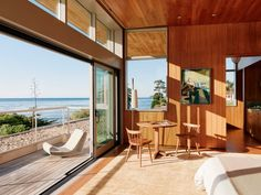 The main dwelling, which rises two levels, is set nearest to the coast. In the rear, a wooden deck provides an opportunity for indoor-outdoor living and a chance to take in the ocean air. Surf House, Chic Beach House, Backyard Pavilion, Front Courtyard, Exterior Cladding, Wooden Decks, Higher Design, Salvaged Wood, Indoor Outdoor Living