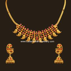 Classic designer antique gold necklace in mango design studded with spinel rubies and emeralds, paired with peacock design gold jhumkis. Gold Bangles Design, Gold Earrings Designs, Gold Jewellery Design, Necklace Designs, Gold Pendent, Mango, Gold Jewelry Simple, Wedding Jewelry, Fashion Jewelry