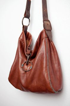 CIBADO leather bags - Soft supple and thick brown leather is carefully hand sewn with the cross stitch on the gussets. Entirely hand sewn with waxed thread incorporating old horse tack to become the handle and ring/halter snap closure