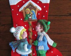 This is a rare stocking kit from 1999 showing Pooh and his friends decorating the tree. I hand cut and stitch my stockings with love and care. Each stocking takes over 35 hours to make and comes completely lined. All beads and sequins are also attached by hand in a smoke free home.  Please let me know in the message box the name of the person to be stitched onto stocking. Name is stitched at the top of stocking.