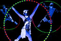 Cyr Wheel performance - one girl and two boys in black light show Crystal UV Light - Anta Agni.