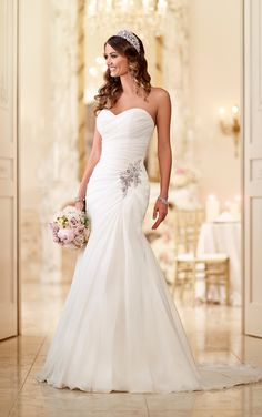 Read about soft Organza fit-and-flare strapless wedding gowns with a figure-flattering bodice from the Stella York wedding dress collection.