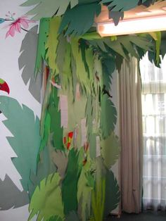 Cut out giant green leaves. I want to do this around my classroom to add a 3-dimensional aspect and give it a jungle feel (maybe in the reading area or around the bulletin board/white board) *link goes to a classroom rainforest activity