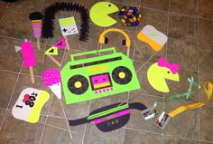 Props made for my 80's party photo booth. Used Bristol board and thick paper glued behind it so that it kept its shape while holding it up. Hot glued sticks as handles that were bought at the dollar store.