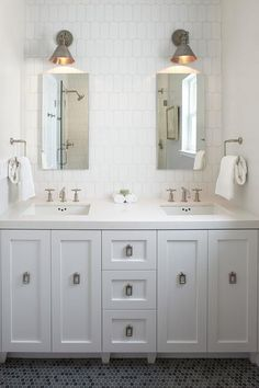 A gray hex tiled floor leads to a nook clad in Ann Sacks Hive Tiles, lined with side by side Robern Medicine Cabinets placed over a white dual washstand adorned with nickel rectangular drop pulls topped with white quartz fitted with his and her sinks.