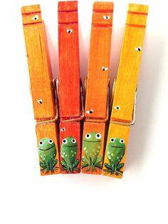 Imanes pintados de naranja de la mano de rana pinzas para la