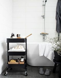 Bar cart in bathroom to hold bath products storage