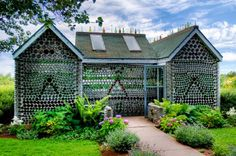 Bottle House - Prince Edward Island - One of several structures built with bottles located on the South shore of Prince Edward Island. This is second version of this house after it was rebuilt due to falling apart. Empty Glass Bottles, Recycled Glass Bottles, Wine Bottles, Reuse Bottles, Soda Bottles, Bottle House, Bottle Wall, Cabana, Recycled House
