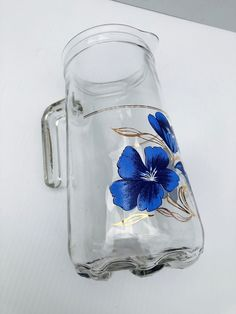 Excited to share this item from my #etsy shop: Vintage Glass Italian Floral Pitcher, Gorgeous Pitcher with Blue Flowers and Gold Accents, Rare, Heavy Glass Pitcher Marked Italy #clear #blue #glass #collectiblepitcher #bluefloralpitcher #italianpitcher #heavyglasspitcher #goldaccentpitcher #floralpitcher