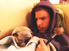 Zachary Quinto eating chocolate ice cream and pouting with a puppy sleeping on him. Switch that for a kitty and you've got a replica of me on a regular day.