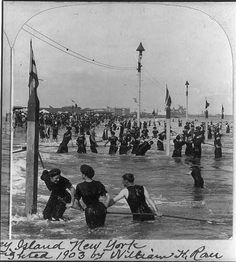 Even before swimming was something most people learned as children, people still enjoyed a dip in the ocean. To avoid getting swept out to sea without any knowledge of how to swim back to shore, beachgoers would cling to these ropes as they climbed in and out of the ocean. Around 1900, these were common at all large beaches, as you can see in this image from Coney Island taken by William H. Rau.
